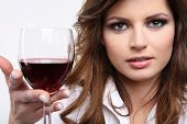 Pretty young brunette enjoying red wine