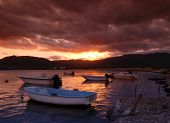 Beautiful sunset over harbor with dramatic sky on Sardinia