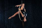 A Young Girl Performs The Acrobatic Elements In The Aerial Hoop. Black Aqua Studio poster