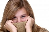 Attractive Young Woman Hiding In A Turtle Neck Sweater