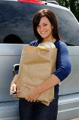 Beautiful Young Woman About To Open The Tailgate To Her Minivan