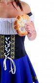 Beautiful Woman Wearing A Traditional Blue Dirndl Costume For Oktoberfest Celebrations Holding A Fresh Pretzel
