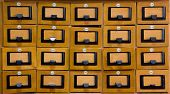 Closed drawers in the library wood catalog.