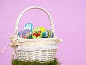 pic of duck egg blue  - Hand painted Easter eggs in basket against light purple background - JPG