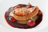 Grilled foie gras with red port sauce, close-up poster