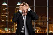 Portrait Of Desperate Mature Businessman. Depressed Male Executive Holding Hands On Head In Desperat poster