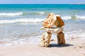 House Made Of Stones Against The Sea, Background Sea. Sea Stones On The Background Of The Sea poster