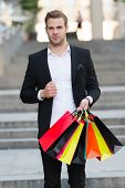 Man Formal Suit Carry Shopping Bags. Guy Carry Bunch Shopping Bags. Profitable Deals Shopping On Bla poster