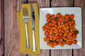 Plated View Of Candy Corn And Candy Pumpkins With Fork And Knife On Wooden Table. Concept For Hallow poster