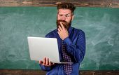 Distance Education Concept. Teacher Bearded Man With Modern Laptop Surfing Internet Chalkboard Backg poster