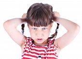 Upset little girl with pigtails over white background