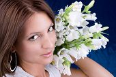 picture of good-looker  - Beautiful brunette with bouquet white flowers - JPG