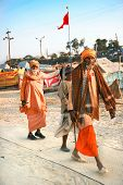 ALLAHABAD, INDIA -11 FEBRUARY: Guru with his disciples on Kumbh Mela the largest religious gathering