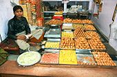 AGRA, INDIA - FEBRUARY 22:Vendor always sits in lotus position while sells goods in Indian shops. Fe