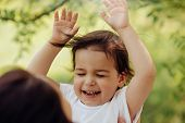Horizontal Portrait Of Happy Smiling Little Cute Daughter Kid Have Fun Outdoors In The Park. Good Re poster