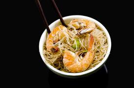 picture of pancit  - Pancit Bihon a Filipino noodle dish on black background - JPG