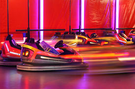 stock photo of amusement park rides  - Bumper cars in motion in amusement park  - JPG