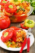 Sweet Peppers Stuffed With Vegetables On A Wooden Table.
