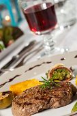 picture of flambeau  - steak with a rosemary leaf and red wine - JPG