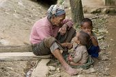 Asia, Old Woman With Grandchildren poster