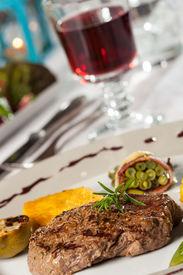 foto of flambeau  - steak with a rosemary leaf and red wine - JPG
