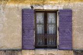 stock photo of lace-curtain  - Charming Lace Curtained Window in old wall in Arles - JPG