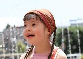 stock photo of playgroup  - Portrait of beautiful happy girl in the city - JPG