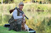 image of hunt-shotgun  - Hunter with dog crouched - JPG