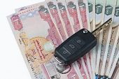 picture of dirhams  - A car key on UAE Dirhams bills - JPG
