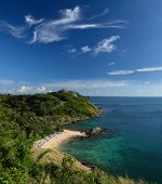 Tropical beach and blue sky with clouds. Ya Nui beach, Phuket island, Thailand