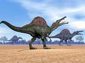 image of dinosaur  - Three spinosaurus dinosaurs walking in the desert by day - JPG