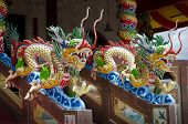PHUKET, THAILAND - MAY 2: Statues of dragons at the entrance to a Buddhist temple on may 2, 2013 in