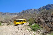 Tour bus climbing at Sani Pass trail between South Africa and Lesotho