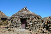 Traditional style of housing in Lesotho at Sani Pass at altitude of 2,874 m.