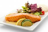 stock photo of salmon steak  - Grilled Salmon with Fresh Salad Leaf - JPG