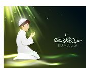 Arabic Islamic Calligraphy of text Eid Mubarak with Muslim boy in tradition outfits reading Namaj ( Islamic Prayer) on shiny green background.