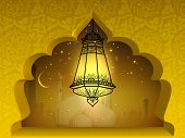 Illuminated Arabic lantern in moonlight night background, concept for Muslim community holy month Ramadan Kareem or Ramazan Kareem.