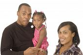 stock photo of niece  - African american man holding a niece in his arms with his sister stand by isolated over white - JPG