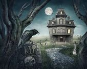 stock photo of manor  - Haunted house and spooky graveyard at night - JPG