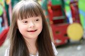 foto of playgroup  - Portrait of beautiful young girl on the playground - JPG