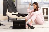 stock photo of annoying  - Tired woman getting ready for business work - JPG