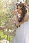 Beautiful Spring Nymph Opening A Vintage Bird Cage