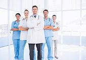 Portrait of confident happy group of doctors standing at the medical office