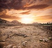 picture of vijayanagara  - Ancient ruins of Vijayanagara Empire at dramatic sky in Hampi Karnataka India - JPG