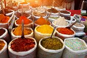 stock photo of yellow-pepper  - Indian colored spices at Anjuna flea market in Goa India - JPG