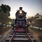 Vintage Steam Engine train with sunset