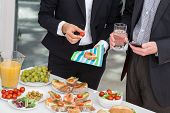 stock photo of buffet lunch  - Managers at office buffet during business lunch - JPG