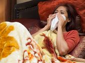 Woman Sick Of Colds On Bed