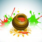 Indian color festival Holi celebration background with traditional mud pot with full of colours on c