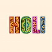 Indian festival Happy Holi celebration concept with colorful floral decorated text Holi on abstract background.